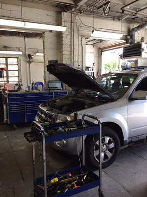 Picture of a ford explorer being repaired